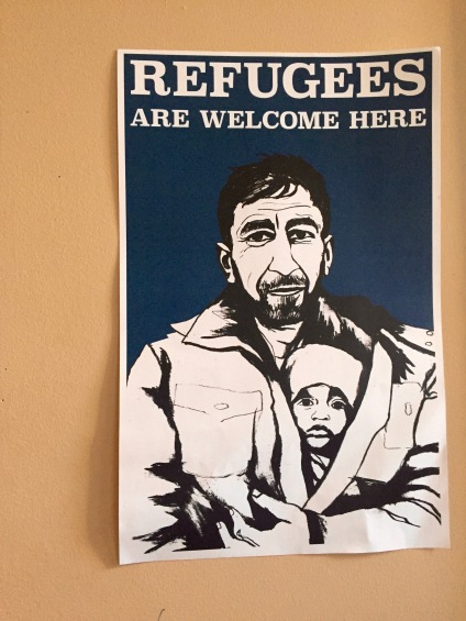 Pro-refugee fliers decorate the walls of the MIRA office.